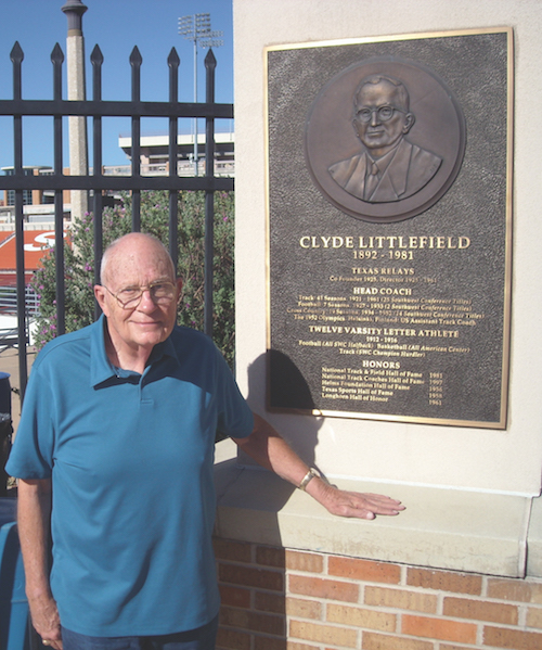 Littlefield stands in front of a dedication plaque for his father Coach Littlefield. Photo: Nick Roland
