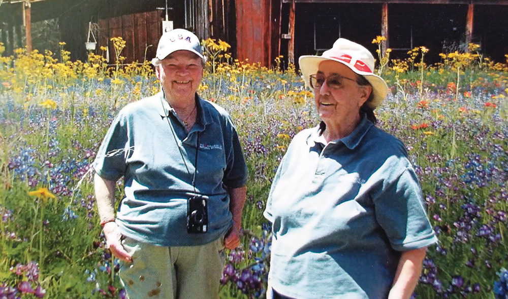 Casey Stengl (right) and her partner Lorraine Wyer in the Stengl Lost Pines wildflower meadow.